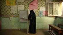 A voter casts her vote at a polling station in Cairo on June 17, 2012. (SUHAIB SALEM/REUTERS)