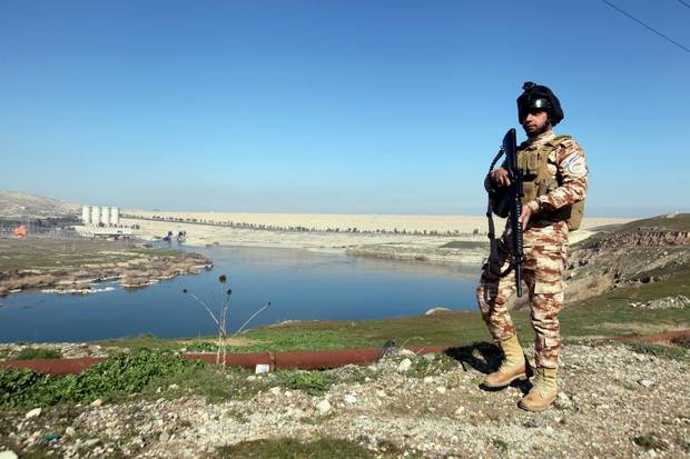 An Iraqi Kurdish Peshmerga stands guard near the Mosul Dam in northern Iraq, February 3, 2016.