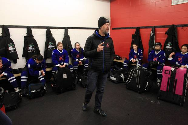 Nunavik Nordiks coach Joe Juneau talks to his players in the dressing room before a game March 24, 2017 in Ottawa. The Inuit girl's hockey team is in Ottawa for a tournament. DAVE CHAN / THE GLOBE AND MAIL