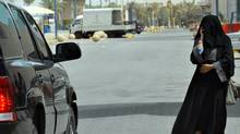 A Saudi woman talks on the phone while walking in Riyadh on June 14, 2011. (AFP/Getty Images/AFP/Getty Images)