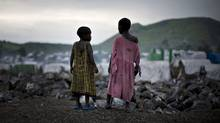 Congolese girls displaced by war stand on the outskirts of a makeshift camp near Goma in eastern Congo in February, 2009. (Finbarr O'Reilly/Reuters/Finbarr O'Reilly/Reuters)