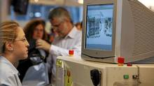 Passengers go through security checks in the departure hall at Ben Gurion international airport near Tel Aviv. (NIR ELIAS/REUTERS)
