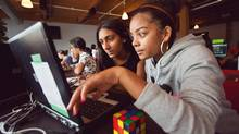 Miha Saluja, 12, and Shanyce Beale, 14, work together to build a computer game at Girls Learning Code Camp in Toronto. (Jennifer Roberts for The Globe and Mail)