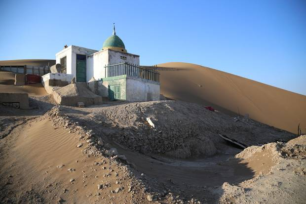 A cemetery is built into the desert in China's Xinjiang region, where the largely Muslim Uyghur population has been blamed for acts of terrorism and for harbouring extremism.