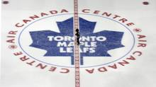 A young boy skates through centre ice at the Air Canada Centre, home of the Toronto Maple Leafs, during a corporate skate in Toronto on Friday December 16, 2011. (Chris Young/The Canadian Press)
