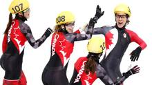 Canadian short track women's relay team Valerie Maltais, Marianne St-Gelais, Marie-Eve Drolet, and Jessica Hewitt celebrate their silver medal win in Sochid Tuesday. (John Lehmann/The Globe and Mail)