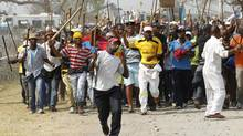 Miners arrive for a march at Rustenburg in South Africa's North West Province, September 13, 2012. (SIPHIWE SIBEKO/REUTERS)
