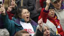 Demonstrators react while listening to B.C .Teachers' Federation President Susan Lambert speech during a rally in Vancouver, British Columbia March 7, 2012. (Ben Nelms/ Reuters/Ben Nelms/ Reuters)