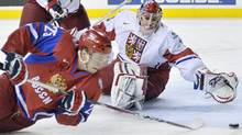 Russia forward Yevgeni Kuznetsov, left, gets stoned by Czech Republic goalie Petr Mrazek, right, during first period quarter final IIHF World Junior Championships hockey action in Calgary, Alta., on Monday, Jan. 02, 2012. THE CANADIAN PRESS/Nathan Denette (Nathan Denette/CP)