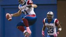 Montreal Alouettes Shea Emry celebrates his touchdown against the Toronto Argonauts during second half CFL action in Toronto on Sunday, Oct. 14, 2012. (Nathan Denette/THE CANADIAN PRESS)
