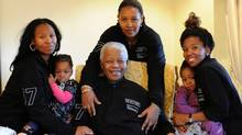 A picture released by the Mandela family shows South Africa's iconic elder statesman Nelson Mandela with family members as he prepares for his 93rd birthday in his home village of Qunu. (Peter Morey/AFP/Getty Images)