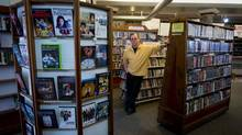 Videomatica co-owner Brian Bosworth is shown at the store in May, 2011. The store's collection of more than 35,000 titles will be kept intact and will be available for public loan. (DARRYL DYCK For The Globe and Mail)