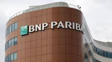 The logo of BNP Paribas is seen on top of the bank company's building in Fontenay-sous-Bois, eastern Paris, May 30, 2014. (CHARLES PLATIAU/REUTERS)
