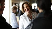 Progressive conservative party leader and Alberta premier Alison Redford (C) is greeted by supporters at a local coffee house during a campaign stop in Calgary, Alberta, April 22, 2012. (TODD KOROL/REUTERS/TODD KOROL/REUTERS)