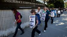 ICBC workers picket recently outside the crown corporation's headquarters in North Vancouver. (DARRYL DYCK For The Globe and Mail)