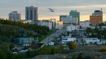 A float plane crosses over the skyline of Yellowknife, Northwest Territories in this file photo. (JEFF MCINTOSH/Canadian Press)