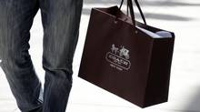 A shopping bag from the luxury brand Coach is seen along Rodeo Drive in Beverly Hills, California, in this May 21, 2013 file photo. (FRED PROUSER/REUTERS)