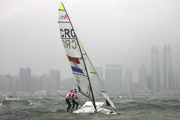 Jonas Warrer (rear) and Martin Kirketerp Ibsen of Denmark take to the sea in a spare boat borrowed from the Croatian team as they compete in the 49er class race held at the Qingdao Olympic Sailing Center during day 9 of the Beijing 2008 Olympic Games on August 17, 2008 in Qingdao, China.