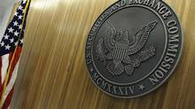 The seal of the U.S. Securities and Exchange Commission hangs on the wall at their headquarters in Washington, in this June 24, 2011 file photo. (JONATHAN ERNST/REUTERS)