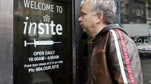 Marc Townsend, manager of the Portland Hotel Society, enters Insite, Canada's only safe injection site for intravenous drug addicts, in Vancouver, Tuesday, October 2, 2007. (RICHARD LAM/The Canadian Press)