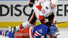 Ottawa Senators' Chris Neil (25) checks New York Rangers' Brian Boyle during the third period of Game 5 of an NHL Stanley Cup first-round hockey playoff series, Saturday, April 21, 2012, at New York's Madison Square Garden. The Senators won 2-0 to lead the series 3-2. (AP Photo/Bill Kostroun) (Bill Kostroun)
