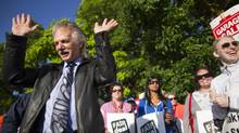 BCTF President Jim Iker talks with teachers on the picket line at Delta Secondary School in Ladner, B.C., on June 17, 2014. (John Lehmann/The Globe and Mail)