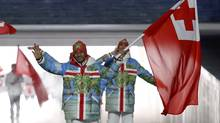 Tonga's flag-bearer Bruno Banani leads his country's contingent during the parade of nations at the opening ceremony of the 2014 Sochi Winter Olympics on Feb. 7, 2014. (PHIL NOBLE/REUTERS)