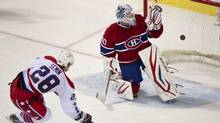 Washington Capitals' Alexander Semin scores on a penalty shot past Montreal Canadiens goalie Peter Budaj third period NHL hockey action Saturday, February 4, 2012 in Montreal. (Paul Chiasson/THE CANADIAN PRESS)