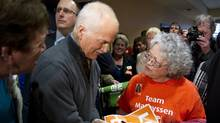 NDP Leader Jack Layton signs an autograph at a rally in London, Ont., on April 4, 2011. (Paul Chiasson/The Canadian Press/Paul Chiasson/The Canadian Press)