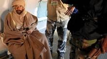 Saif al-Islam Gaddafi is pictured sitting in a plane in Zintan Nov. 19, 2011. (Ismail Zitoumi/REUTERS/Ismail Zitoumi/REUTERS)