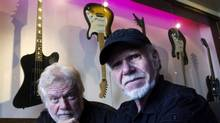 Randy Bachman, left, and Fred Turner, right, pose in Toronto on Tuesday, August. 24, 2010. (Nathan Denette/THE CANADIAN PRESS)