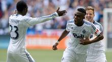 Vancouver Whitecaps' Kekuta Manneh, of Gambia, from left to right, Gershon Koffie, of Ghana, and Jordan Harvey celebrate Koffie's goal against the Seattle Sounders during the second half of an MLS soccer game in Vancouver, B.C., on Saturday May 24, 2014. (The Canadian Press)