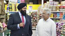 MLA Manmeet Bhullar (left) speaks with Onkar Janjua owner of the Fruiticana grocery store in an Indian neighbourhood of Edmonton October 7, 2011. Manmeet Bhullar is Sikh and Alberta's youngest MLA. (Jason Franson for The Globe and Mail/Jason Franson for The Globe and Mail)