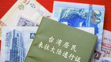 Taiwanese banknotes and passport. (TPG/Newscom)
