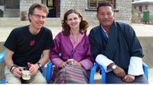 Wearing traditional Bhutanese dress, Andrea Giesbrecht is joined on a tea break at the Tashidingkha Middle Secondary School in the Punakha Valley, Bhutan, by an unidentified visitor, left, and Karma, a Bhutan Canada Foundation staff member.