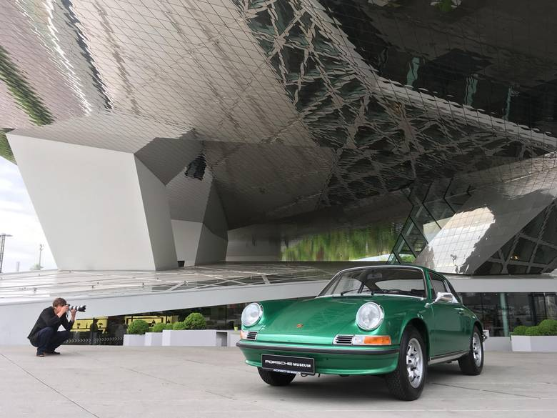 A classic Porsche photographed in front of the museum in Stuttgart.