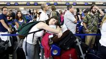 Another frustrating airport lineup. (JOSHUA LOTT/REUTERS)