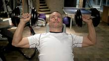 Brett Wilson works out in his custom home gym in Calgary, (Chris Bolin for The Globe and Mail)
