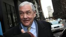 Former media baron Conrad Black leaves the Dirksen Federal Building following a status hearing on his criminal conviction January 13, 2011 in Chicago, Illinois. (Scott Olson/Getty Images)