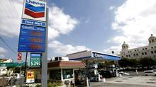 A Chevron sign is seen at a gas station in Los Angeles, Oct. 9, 2012. (MARIO ANZUONI/REUTERS)
