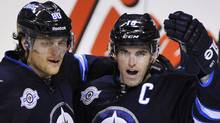 Winnipeg Jets' Andrew Ladd (3rd L) celebrates his second period goal against the Toronto Maple Leafs with teammates Nik Antropov (L) and Kyle Wellwood (not pictured) during their NHL hockey game in Winnipeg December 31, 2011. REUTERS/Fred Greenslade (Fred Greenslade/Reuters)