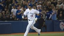 Toronto Blue Jays right fielder Jose Bautista rounds the bases after hitting a solo homerun against the Texas Rangers during third inning AL action in Toronto on Tuesday, May 1, 2012. (Nathan Denette/Nathan Denette/THE CANADIAN PRESS)