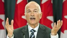 NDP Leader Jack Layton explains his compromise proposal on the long-gun registry during an Ottawa news conference on Sept. 16, 2010. (Adrian Wyld/THE CANADIAN PRESS)
