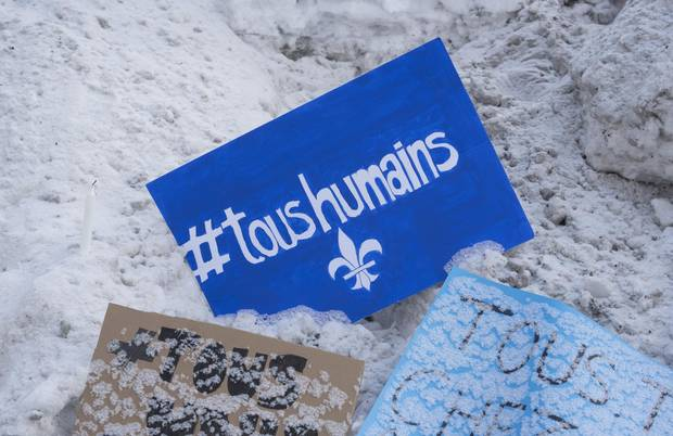 "A message with the slogan ""all human"" and the Québécois fleur-de-lis lies near the Centre culturel Islamique de Québec on Jan. 31, 2017."