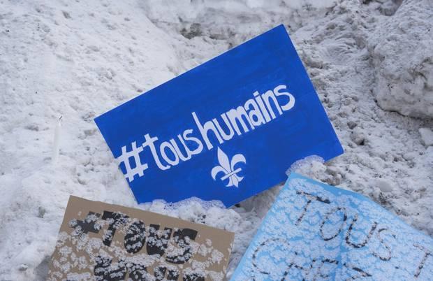 """A message with the slogan """"all human"""" and the Québécois fleur-de-lis lies near the Centre culturel Islamique de Québec on Jan. 31, 2017."""