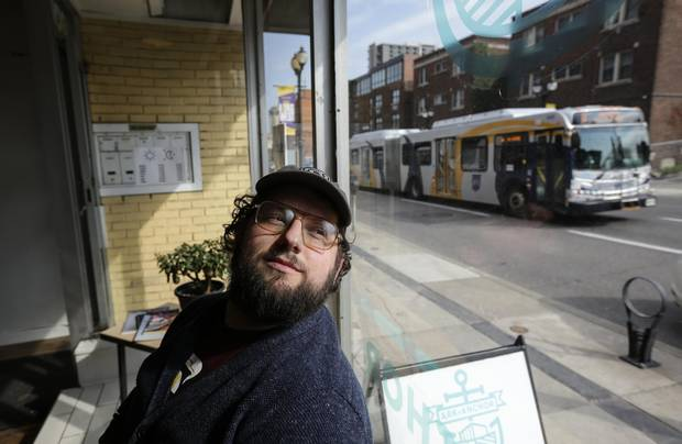 Patrick Guilbault, co-founder of a coffee bar on King Street West, supports the LRT