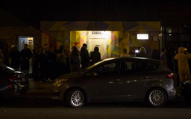 People line up outside The Cobalt Cabaret in Vancouver, B.C., on Friday October 27, 2017.