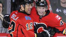 Calgary Flames' Jarome Iginla (L) and teammate Sven Baertschi celebrate Baertschi's goal during the second period of their NHL game against the San Jose Sharks in Calgary, Alberta March 13, 2012. (TODD KOROL/REUTERS)