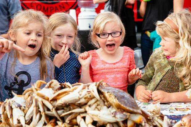 Children check out the crabs at Feast Tofino in May, 2015.