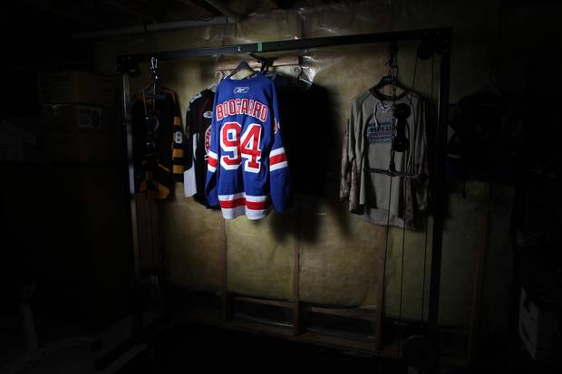 Jersey of late NHL player Dereck Boogaard is on display at his father Len Boogaard's basement gym January 5, 2017 in Ottawa.